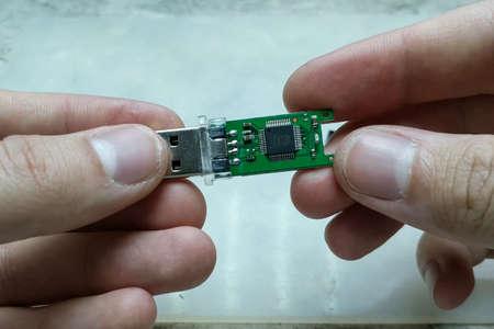 Repair USB stick. USB stick USB In the hands of a master repairman. Фото со стока