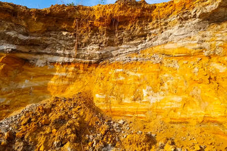 The slopes are a quarry with a rock containing gold. Searching for gold.