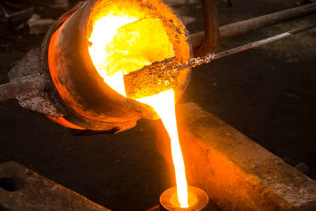 A large bowl of molten metal at a steel mill. Steel production.
