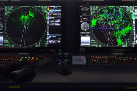 Ship control panel. a Navigational devices and echolocation and radar monitors.