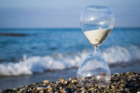 Hourglass on the beach, on the Mediterranean coast