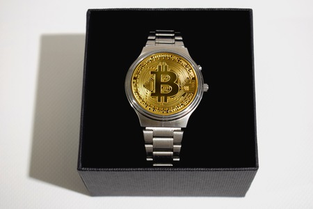 Wrist watch screen bitcoin. Crypto, Concept business, idea: time to earn, buy or sell bitcoin
