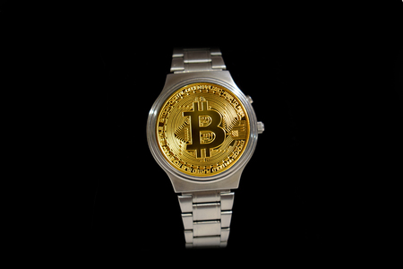 Wrist watch screen bitcoin on black background. Crypto, Concept business, idea: time to earn, buy or sell bitcoin