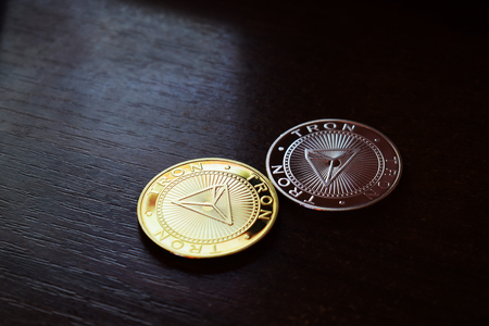 Tron TRX coins on wooden background. Digital money. Banco de Imagens