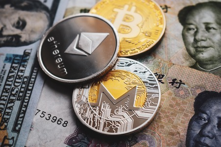 Bitcoin BTC, Ethereum ETH, Monero XMR coins on Chinese Yuan and US dollars banknotes. Close-up 스톡 콘텐츠