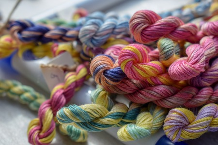 Multicolored threads of floss braided threads for embroidery. Colorful braided thread.
