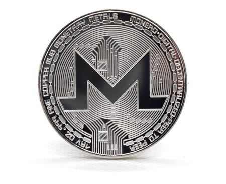 Silver Monero (XMR) coin isolated on a white background Stock Photo