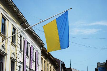 Ukraine, Lviv - May, 2019 Flag of Ukraine on pole on building wall in Lviv