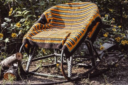 Rocking chair in the open air. Wicker chairs for relaxing.