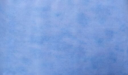 Background of dyed fabric. Beautiful abstract background. Sky, sea, blue background
