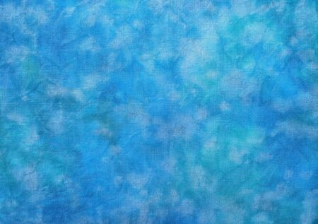 Background of dyed fabric. Beautiful abstract background. Sky, sea, blue background.