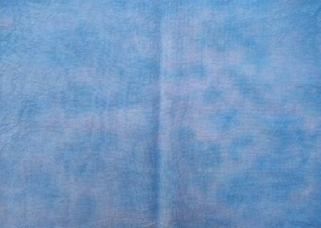Background of dyed fabric. Beautiful abstract background. Sky, sea, blue background. Banque d'images