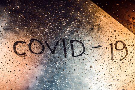 The inscription Coronavirus on the misted glass. Pandemic. Banco de Imagens