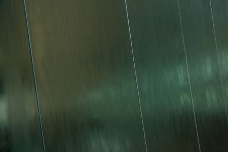 water flowing: Water flowing over the mirror metal surface. Architectural modern background concept.