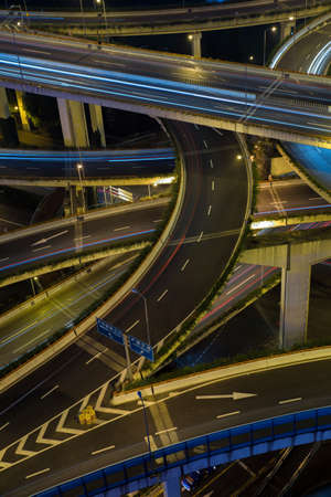 city traffic: Modern city traffic road at night. Junction.