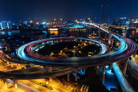 shanghai night: Modern city traffic road. Transport road junction on the bridge.