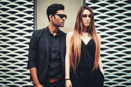stylish hair: Young trendy man and woman models posing of the modern street. Fashion Style