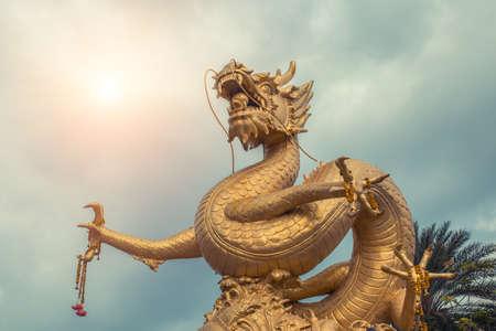 Golden gragon statue. Phuket, Thailand. Stock Photo