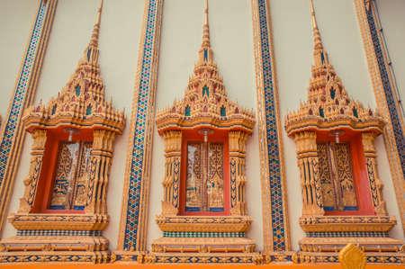 Ancient Thai temple. Wat Kosit Wihan golden Temple Phuket, Thailand. Decor windows architecture wall.