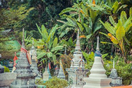 Ancient mystical thai cemetery near old temple. Thailand. Banco de Imagens