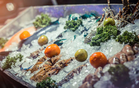 Seafood on ice at the night fish market. Thailand.