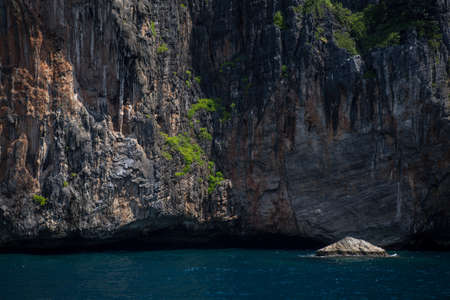 Cliff and the clear sea Phi Phi islands south of Thailand. Phi phi high rocks islands.