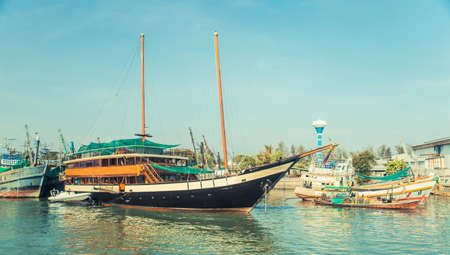 Old wreck Ship Harbor fishing and travel boat stranded. Thailand.