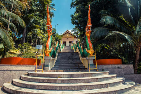 Stairs with dragons to the Thai temple. Wat Patong Suwankeereewong Temple Phuket, Thailand.