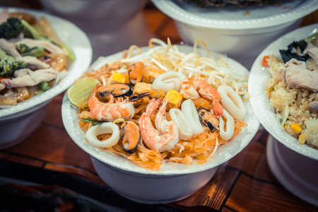 Noodles with seafood. Night food market, Thailand.