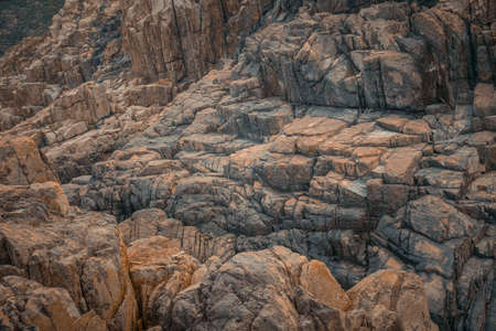 Texture of the rock stone cliff background.