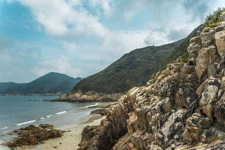 Huge stone rock cliff mountains and sea landscape. Banco de Imagens