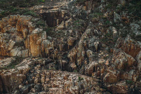 Stone mountain cliff texture background. Banco de Imagens