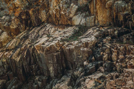 Stone crags mountain cliff texture background.