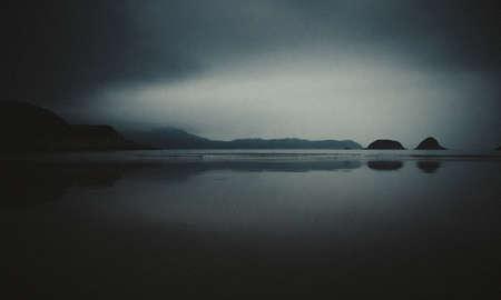 Blur long exposure seascape scenery in night Black and white. Soft film grain style. Banco de Imagens - 78177015