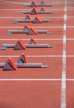Athletics Starting Blocks on a red running track in the stadium.