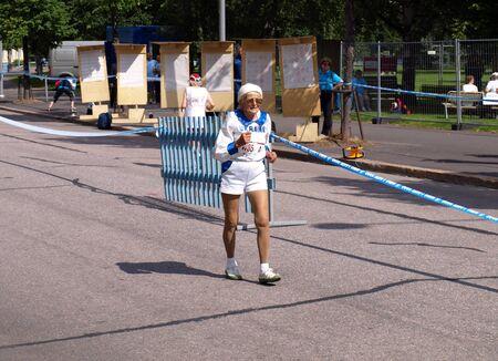 stadia:  Olena Chub, Born in 1924, on 20 kilometers race walk distance on the World Master Athletics Championships Stadia on August 3, 2009 in Lahti, Finland.