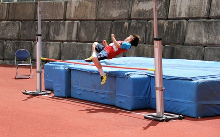 high jump: Boy compete in the high jump. Stock Photo