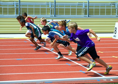 KAMLOOPS, CANADA-JULY 23:unidentified boys on the start of the 100 meters dash on the BC Junior Development Track and Field Championships July 23, 2011 in Kamloops , Canada