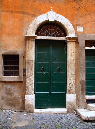 rom: Exterior of the typical old door in Rome, Italy. Editorial