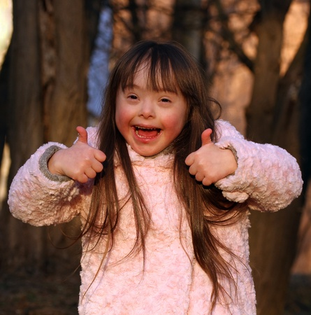 Portrait of beautiful happy girl giving thumbs up Stock Photo