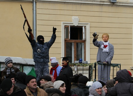 A man dressed as a Timoshenko on Malanca Folk Festival in Chernivtsi, Ukraine on January 15, 2012. The former Prime Minister was jailed in October for gas deal with Russia