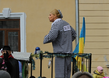 chernivtsi: A man dressed as a Timoshenko on Malanca Folk Festival in Chernivtsi, Ukraine on January 15, 2012. The former Prime Minister was jailed in October for gas deal with Russia