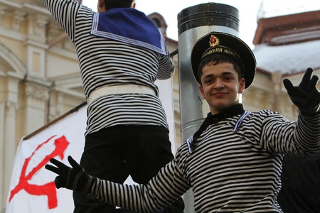 chernivtsi: Naval ship with the sailors and the symbolism of the Soviet Union on Malanka Folk Festival in Chernivtsi, Ukraine on January 15, 2012. Editorial