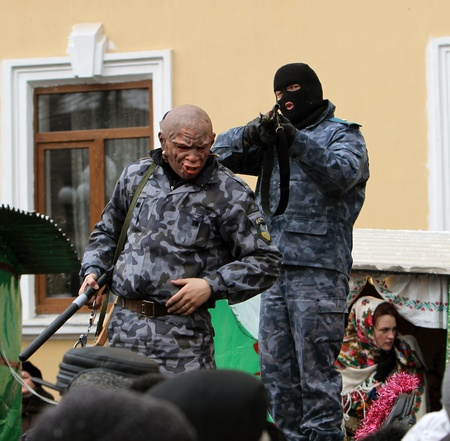 combines:  dressed people on Malanka Festival in Chernivtsi, Ukraine on January 15, 2012. Ukraines Malanka festival combines various elements of Halloween, Mardi Gras and New Years. Editorial