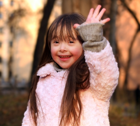 Down Syndrome: Portrait of beautiful happy girl. Stock Photo