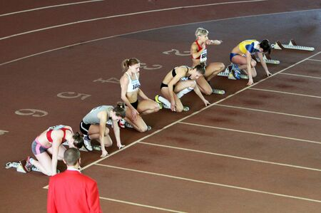 Girls on the 60 meters dash on the Ukrainian Cup in Athletics on January 27, 2012 in Zaporizhia, Ukraine. Stock Photo - 12512947