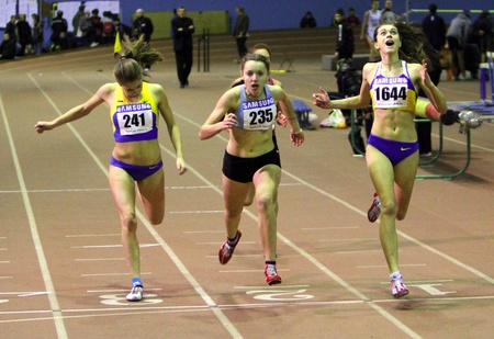 (L-R) Moroz Ulia, Sidor Oleksandra and Klimuk Katerina wins the 400 meters race on Ukainian Junior Track and Field Championships on January 30, 2012 in Zaporizhia, Ukraine