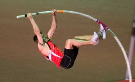 summer olympics:  Denys Yurchenko on the Ukrainian Cup in Athletics, on January 27, 2012 in Zaporizhia, Ukraine. He won bronze medal in the pole vault event at Summer Olympics in Beijing. Editorial