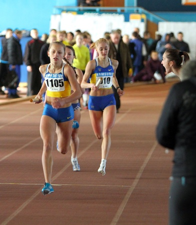 Girls run relay race on Ukainian Junior Track and Field Championships on January 31, 2012 in Zaporizhia, Ukraine