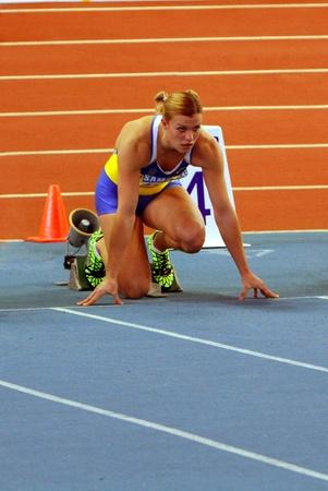 pentathlon: SUMY, UKRAINE - FEB 16  Dobrynska Natallia - Olympic Champion in Beijing wins the Pentathlon with National Record 4880 p  on Ukainian Track   Field Championships on February 16, 2012 in Sumy, Ukraine